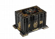 TEA CADDY - English Chinoiserie Tea Caddy in black lacquer with mother-of-pearl and gilt decoration, having a slightly domed hinged lid with linenfold sides, footed molded base, two-compartment interior with lids, cir...