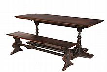 TRESTLE TABLE & BENCH - Paine Furniture, Boston, Mass, circa 1925, Renaissance revival, in walnut, the table with two-toned top having butterfly joints, ring and turned urn pedestals, crossed T molded platform with fo...