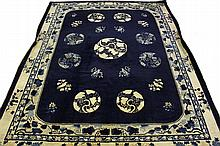 CHINESE CARPET - 10' x 12 1/2' - Early 20th c, with nine circular floral medallions in royal blue and ivory.