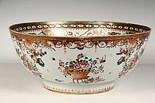 CHINESE PORCELAIN BOWL - Early Deep Bowl with deep foot, having well executed and unusual famille rose decoration, the exterior featuring hanging floral baslkets and arrangements on stands, the interior with rose and ...