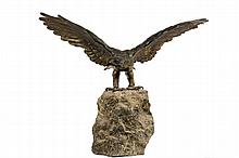 BRONZE SCULPTURE - Full Body Cast Bronze American Eagle with wings spread, head down and to the right, mounted atop rough hewn vertical stone plinth