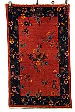 CHINESE ART DECO RUG - 3' x 5' - China, second quarter 20th c, sitting and flying phoenix in navy, sky blue and gold. Set on a rosette decorated cinnamon field, navy blue vine and rosette border.