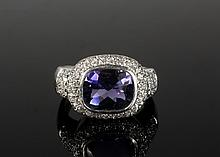 LADY'S RING - Tanzanite and 18K White Gold Lady's Ring. Size 11 1/4.