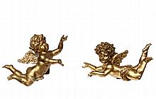 PAIR OF CHERUBS - Italian Carved Giltwood Wall-Mount Cherubs in Flight, with opposing stances, probably Florentine, late 19th to early 20th c