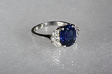 LADY'S RING - Platinum, Oval Sapphire, Pear and Marquise Diamond Ring. Set with a 3.70 carat oval natural sapphire flanked by two oval diamonds and four marquise-cut diamonds, color G/H, clarity, VS. The total diamond..