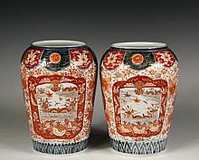 PAIR OF JAPANESE PORCELAIN VASES - Fine Imari High Shouldered Vases with broad mouths, Guangxu mark (1875-1908), in typical brick red and cobalt blue decoration featuring Phoenix cartouches and lake panels, 10