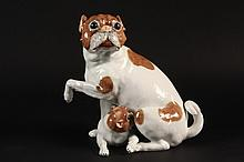 PUG FIGURINE - Carl Thieme Dresden Figurine Depicting a Mother Pug Dog and Puppy, early 20th Century. 9 1/4