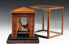 GARDEN PAVILLION - Carved Wooden Garden Pavillion with Two Seated Figures, varnished softwood. 10