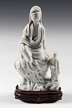 CHINESE PORCELAIN FIGURE - 19th c. Seated Quan Yin with Standing Child, in pale celadon glaze, on carved wooden stand. 6 5/8