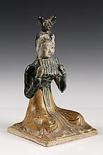 CHINESE POTTERY FIGURE - Tang Style Sancai Glaze Seated Lady Musician with set of pan flutes raised to her chin, ornate coiffure. 6 1/2