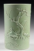 CHINESE PORCELAIN - Cylindrical Brush Pot in celery green glaze, with relief decoration of woman riding water buffalo past bare tree, s