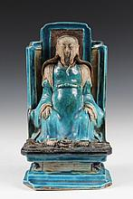 CHINESE PORCELAIN - Fa Hua Shrine Figure of an Official, in aqua and black glazes with serpent and turtle at his feet, on integral plin