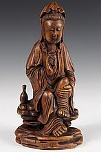 CHINESE BAMBOO CARVING - Figure of Quan Yin seated on rock, bottle alongside, making gesture of contemplation. Inscription on back. Lat