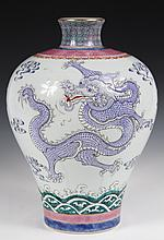 CHINESE PORCELAIN - Large 20th c. Meiping Vase painted in famille rose enamels with raised dragons, one pink, one blue. Dao Guang mark.