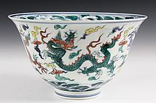 CHINESE PORCELAIN - Large Deep Wucai Bowl decorated with dragons and having Ming mark, (possibly Kangxhi). In box. 4 7/8