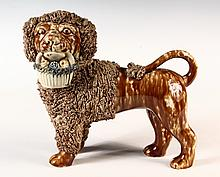 RARE BENNINGTON POTTERY FIGURINE - Standing Lion with Fruit Basket in Mouth, facing left, with textured ears, ruff and tail, in brown s