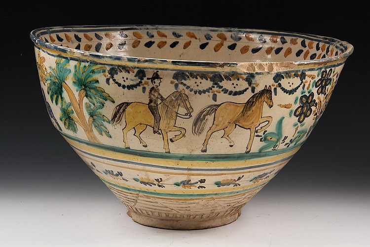 POTTERY PUNCHBOWL - Spanish Colonial Tin Glazed Majolica Punchbowl decorated with horsemen, trees, butterflies & birds,  inscribed 'Dn