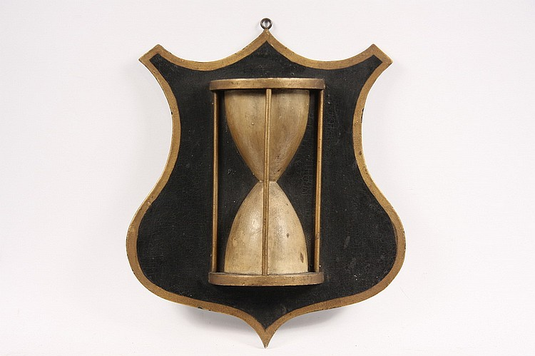 TRADE SIGN - Late 19th c  American Watchmaker's Trade Sign in the form of an hourglass on a shield, in gold and black painted wood wit