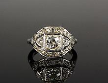 LADY'S RING - Art Deco Platinum and Old European Cut Diamond Ring, with central box mounted stone surrounded by diamonds in domed, pie
