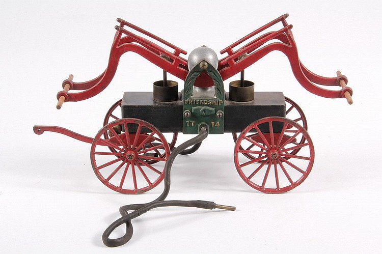 TOY PUMPER - Early 20th c. Cast Iron Friendship 1774 Working Toy Pumper, wooden hand bars with original rubber hoses, has original red,