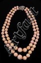 NECKLACE - Double strand graduated pink coral bead necklace with 14K white gold and diamond clasp, beads graduate from 8 mm to 16 mm, c
