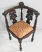 Reproduction carved figural corner chair