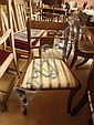 A set of 8 reproduction mahogany dining chairs in