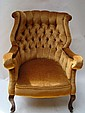 A late Victorian upholstered button back armchair