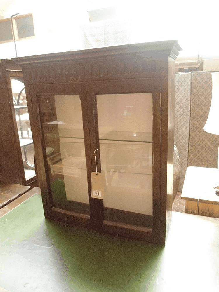 A 1930's oak wall cupboard glazed