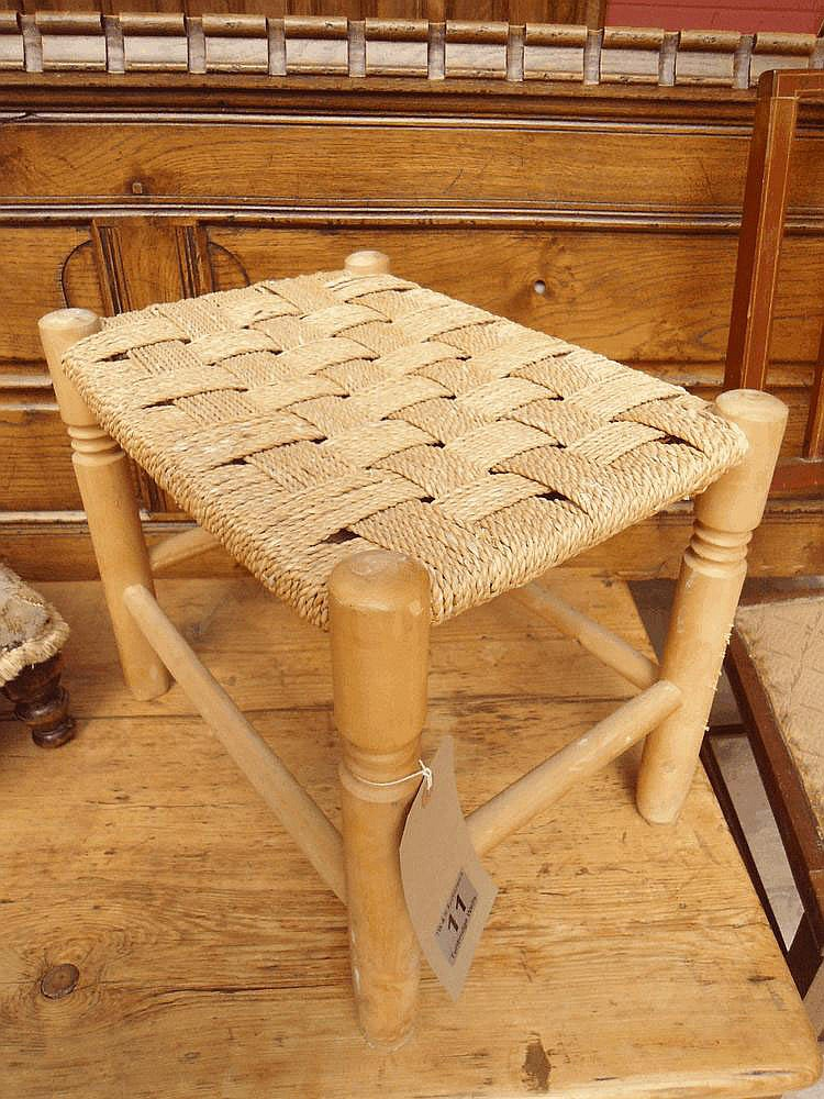 A beech framed stool upholstered in sea grass