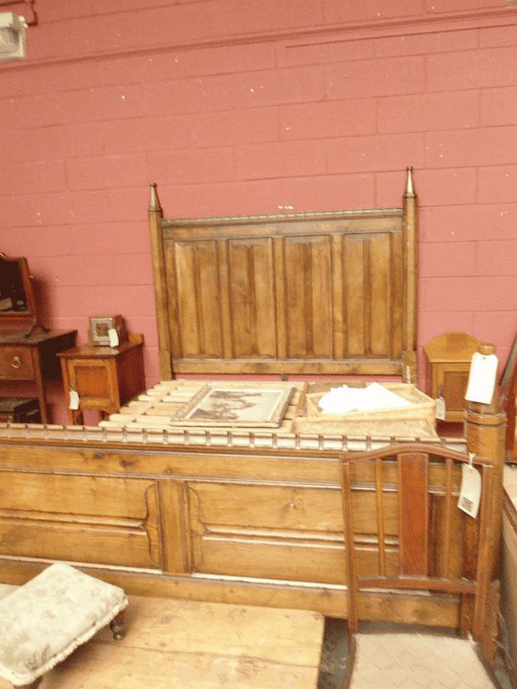 An oak Gothic style double bedstead manufactured
