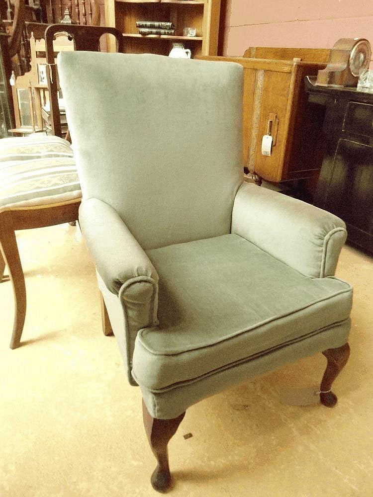 A modern armchair upholsted in dralon