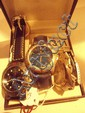 Hugo Buchser quartz cased gents wristwatch and a