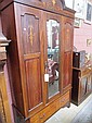 An Edwardian inlaid mahogany wardrobe