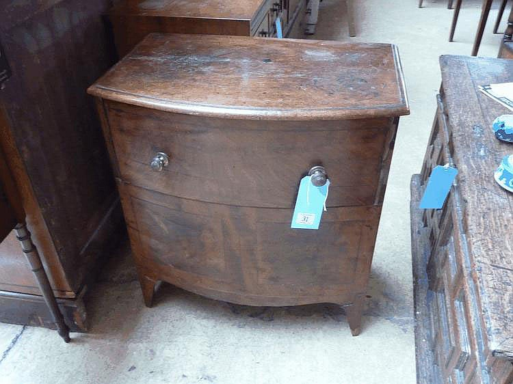 An early C19 mahogany bow fronted commode with