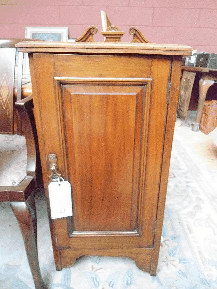 An Edwardian walnut bedside cabinet