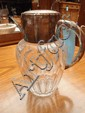 A 20thC waterjug with silver plate mouths