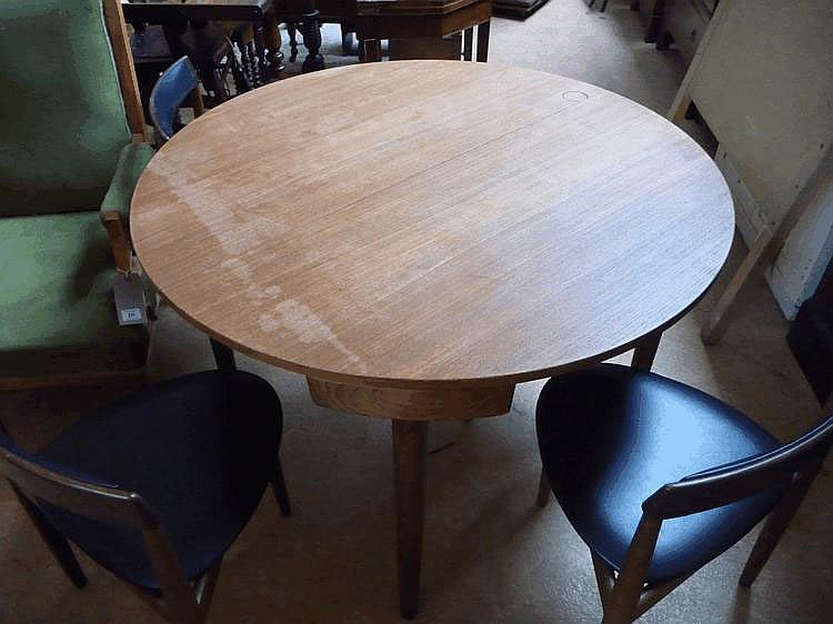 A 1960's Danish extending beech dining table and