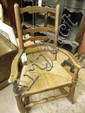 A 19thC beech ladderback rocking chair upholstered