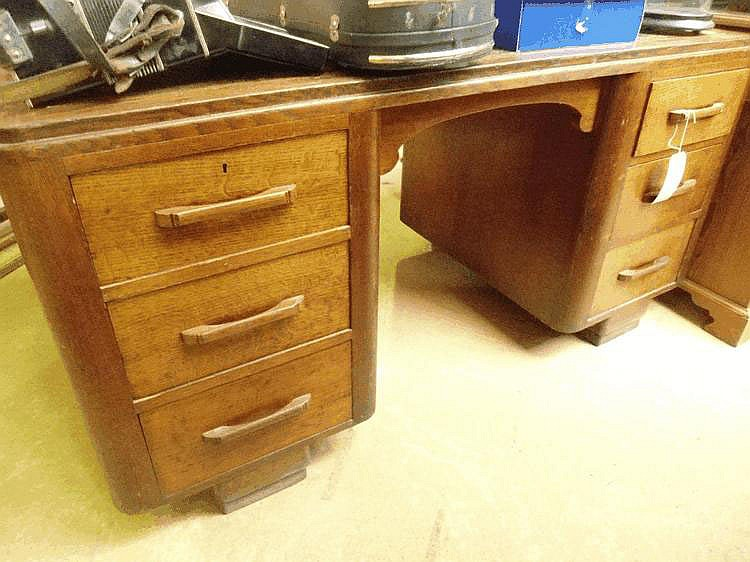 A 1930's oak partners desk, possibly Heals