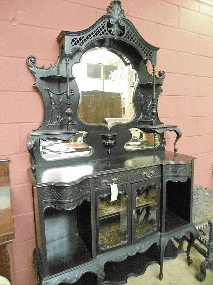 A late 19 century ebonised display cabinet.