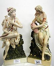 A pair of Royal Dux figurines