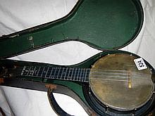 A 'Jolli Joe' banjo with original hand case