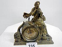 A brass mariner mantel clock