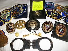 A collection of American police badges for Officer Ralph Cameron Lacy