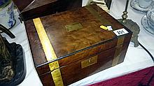 A mahogany brass round writing table with inkwells