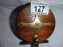 An old wooden fishing reel