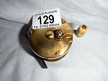 An old brass fishing reel