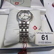 A boxed Swiss Pulse wrist watch, in working order