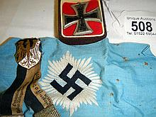 Three items of German military memorabilia consisting of a blue armband with Nazis Swastika, replica Iron Cross and a Prussian badge